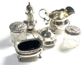 selection of silver items inc salt pepper milk jug etc total weighable silver weight 200g