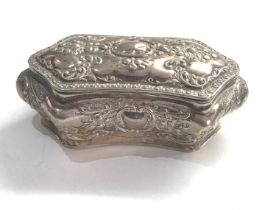 Antique silver hinged lid embossed box measures approx 14cm by 7.5cm height 5.5cm weight 140g