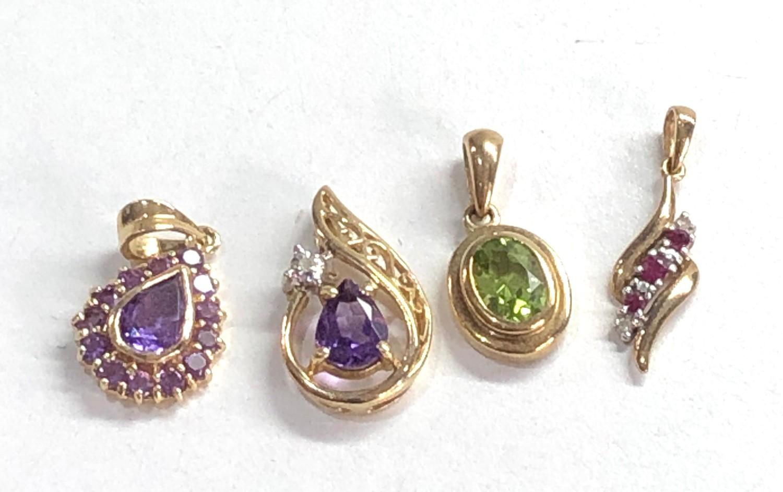 4 x 9ct gold gemstone pendants inc. peridot, amethyst