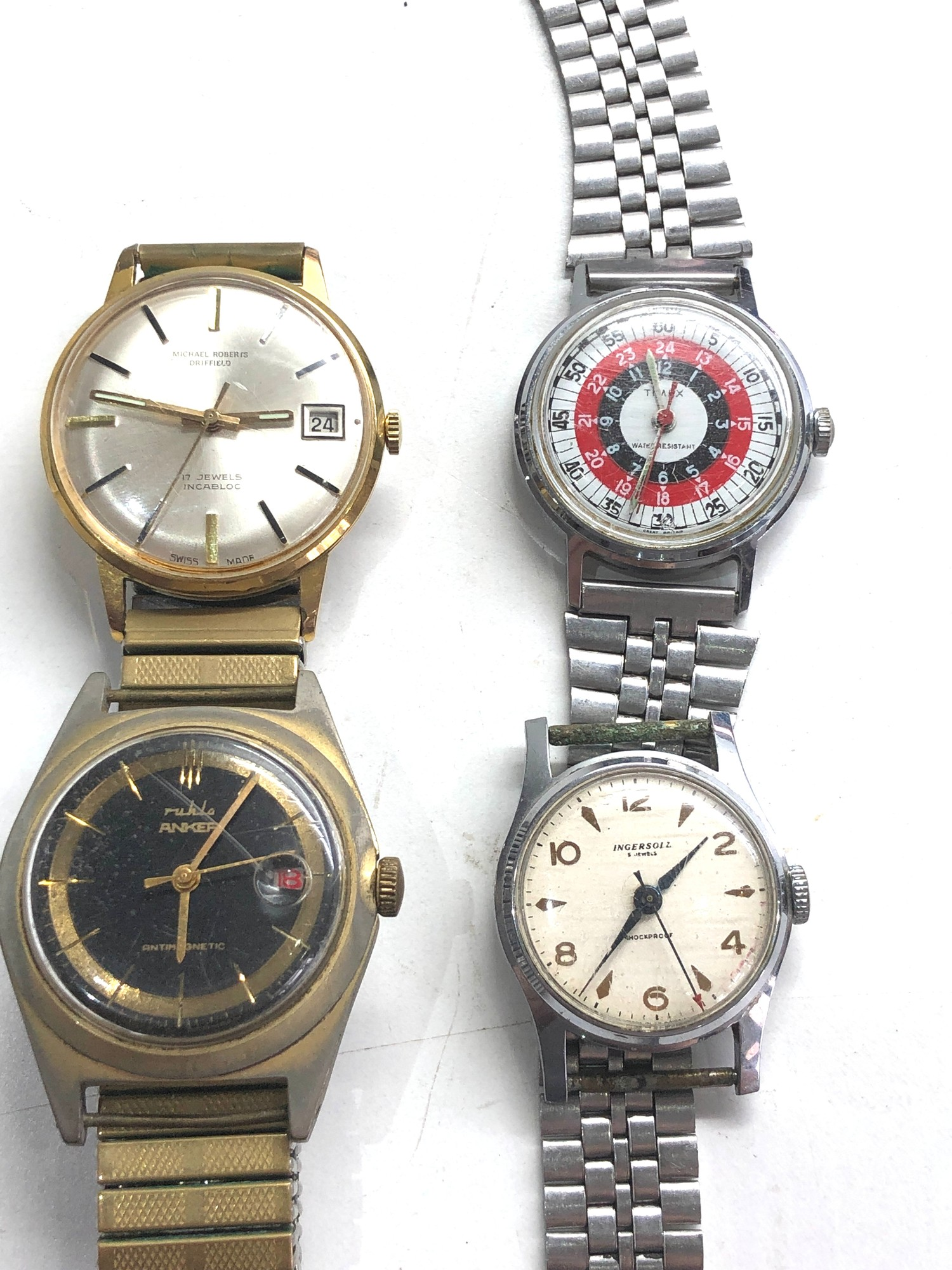 Selection of 4 vintage gents wristwatches includes ingersoll timex ruhla and michael roberts