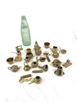 Selection small brass pieces, advertising glass bottle