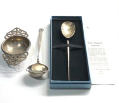 2 silver spoons and silver tea strainer