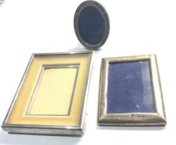 3 silver picture frames largest measures approx 14cm by 11cm