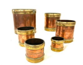 Selection vintage brass and cooper measuring cups