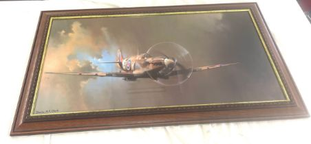 Framed print of a Spitfire by Barrie A F Clark, approximate measurements: Height 11 inches, Width 40