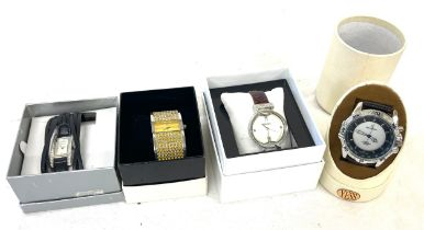 Selection of 4 boxed Henley, Yess and Spirit battery operated ladies and mens watches, all in