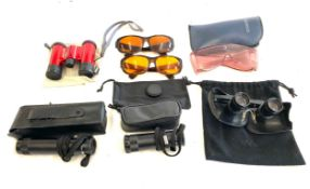 Large selection of assorted glasses includes eschenbach tele 4x, specwell 3.5, nikon binoculars etc