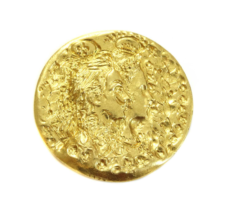 A gold medallion 'Dali d'Or' designed by Salvador Dali, c.1966,