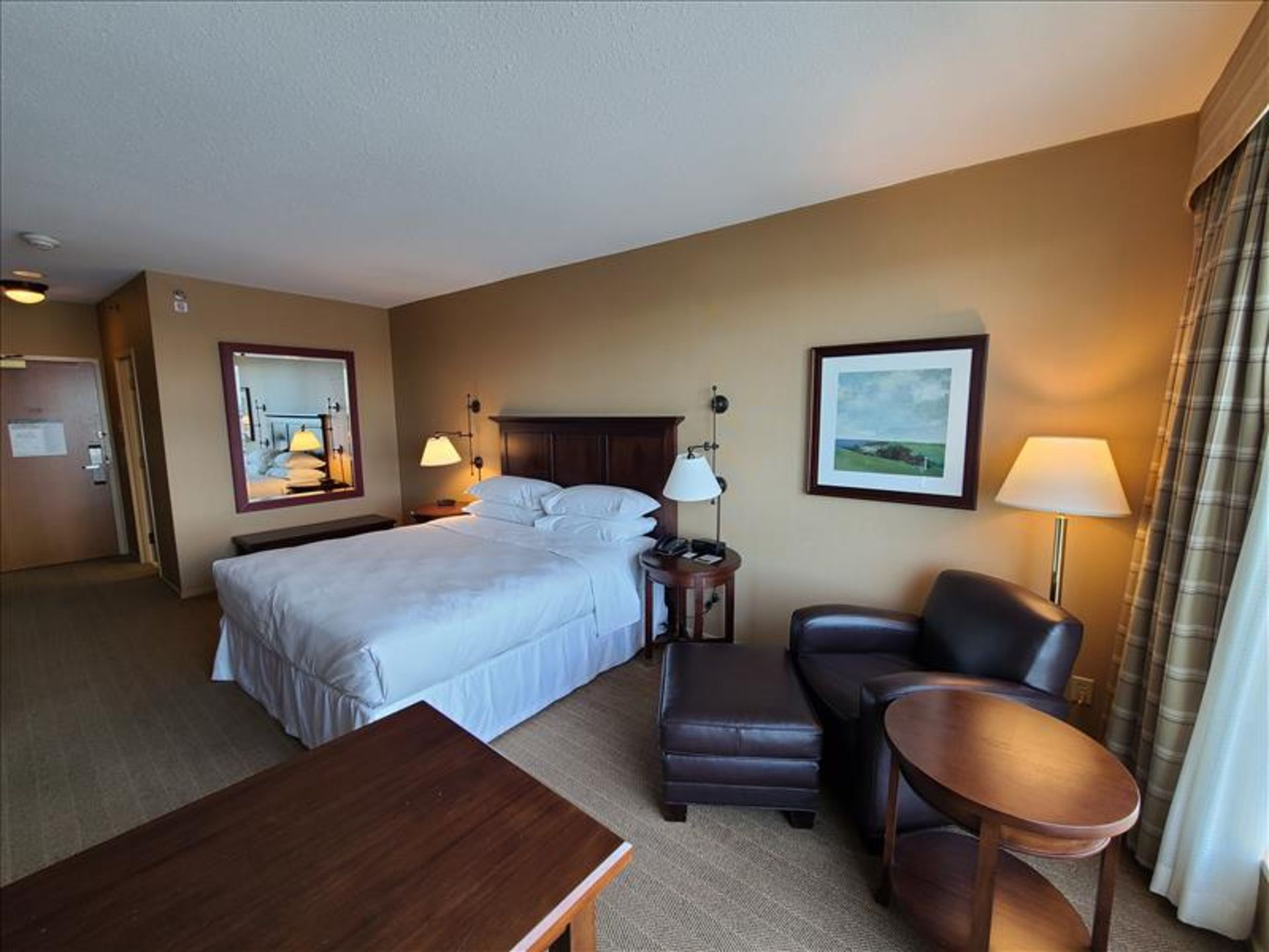 King Bedroom featuring: king size bed and frame, wood headboard, night stand, desk, desk chair, side