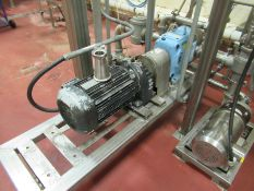 Waukesha stainless positive displacement pump, mod 130 U, s/n 890019, with 7.5 hp motor on stainless