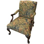 A Victorian George III style mahogany framed 'Gainsborough' armchair. ?This 'Gainsborough' style