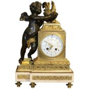 Empire style mantel (fireplace) clock with white marble base. Classical gilt bronze detail to clock