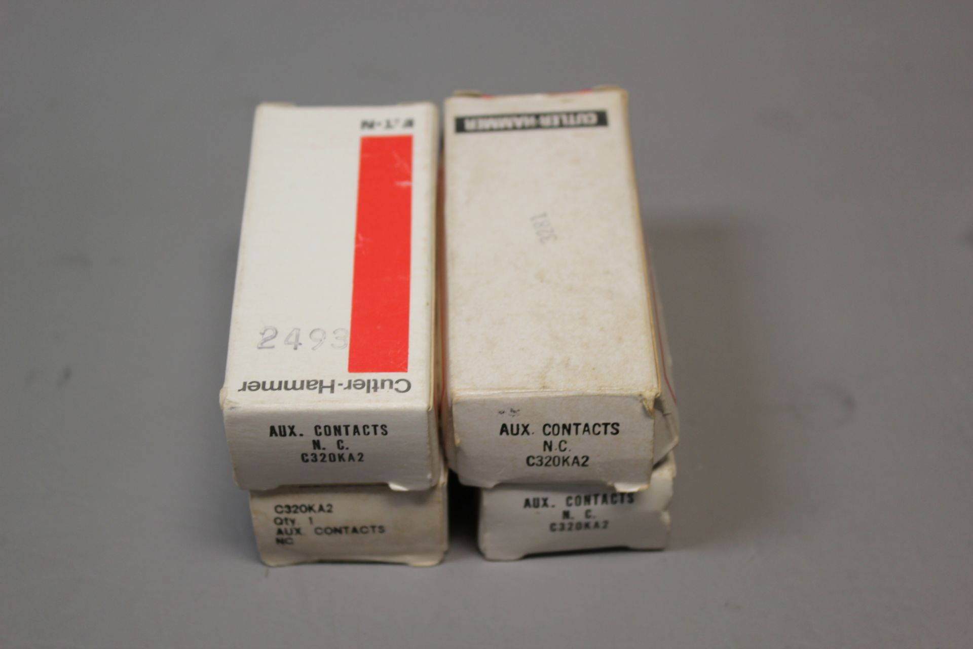 LOT OF NEW CUTLER HAMMER AUXILIARY CONTACTS