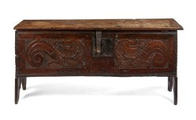 A mid 17th century oak carved chest