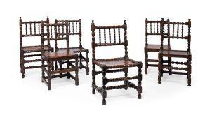 A matched set of six Charles II joined oak backstools, circa 1680