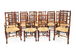 A matched set of sixteen 19th century elm and ash spindle back dining chairs