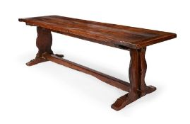 A French oak trestle table, mid 19th century