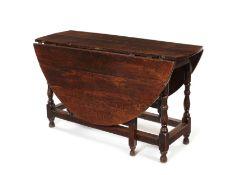 A George I oak gate-leg dining table