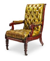A George IV mahogany green leather patent reclining library armchair by Daws