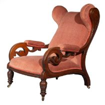 A Victorian carved mahogany wing back armchair