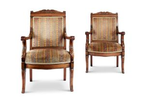 A pair of Empire mahogany caved fauteuils