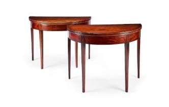 A pair of George III mahogany demi-lune tea tables