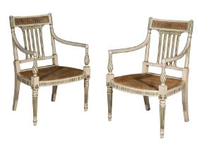 A pair of George III white and green painted open armchairs