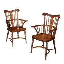 A pair of Victorian mahogany Windsor open armchairs attributed to William Birch
