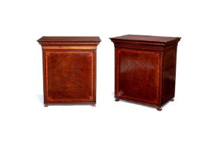 A pair of figured mahogany and satinwood crossbanded revolving cutlery boxes