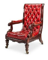 A George IV mahogany red leather patent reclining library armchair by Robert Daws