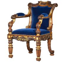 A George IV rosewood and parcel gilt carved armchair attributed to Gillows