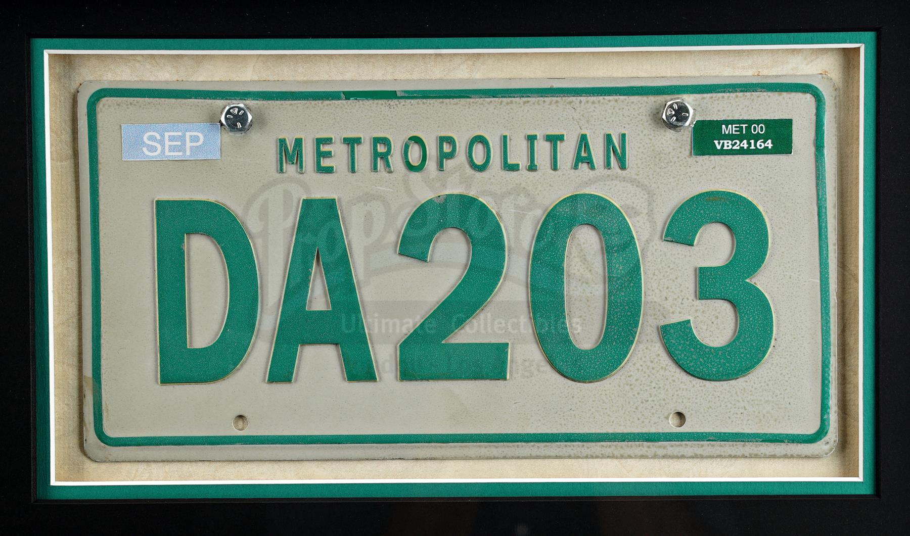 Lot # 869: THE MATRIX RELOADED - Trinity's (Carrie-Anne Moss) Cadillac CTS License Plate Display