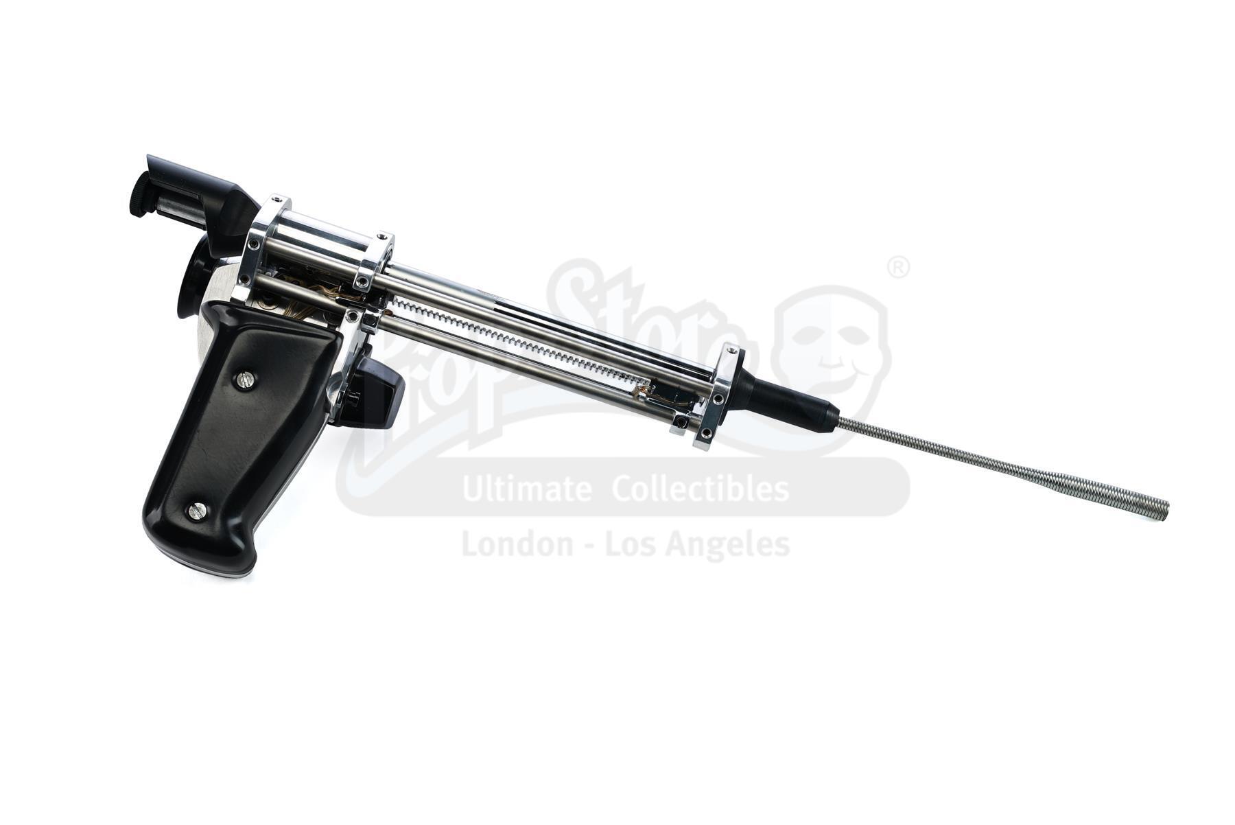 Lot # 390: TOTAL RECALL - Douglas Quaid's (Arnold Schwarzenegger) Tracker Extractor Tool