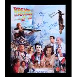 Lot # 497: BACK TO THE FUTURE TRILOGY - Michael J. Fox, Christopher Lloyd & Cast Autographed Poster