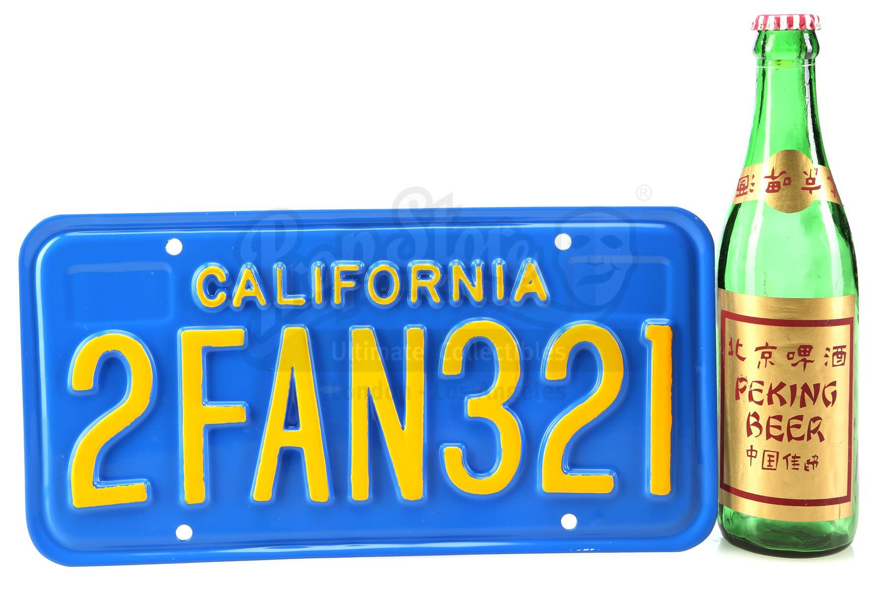 Lot # 535: BIG TROUBLE IN LITTLE CHINA - Jack Burton's (Kurt Russell) License Plate and Beer Bottle