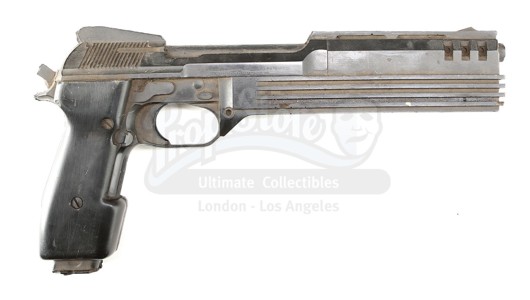 Lot # 217: ROBOCOP - RoboCop's (Peter Weller) Auto 9 Pistol