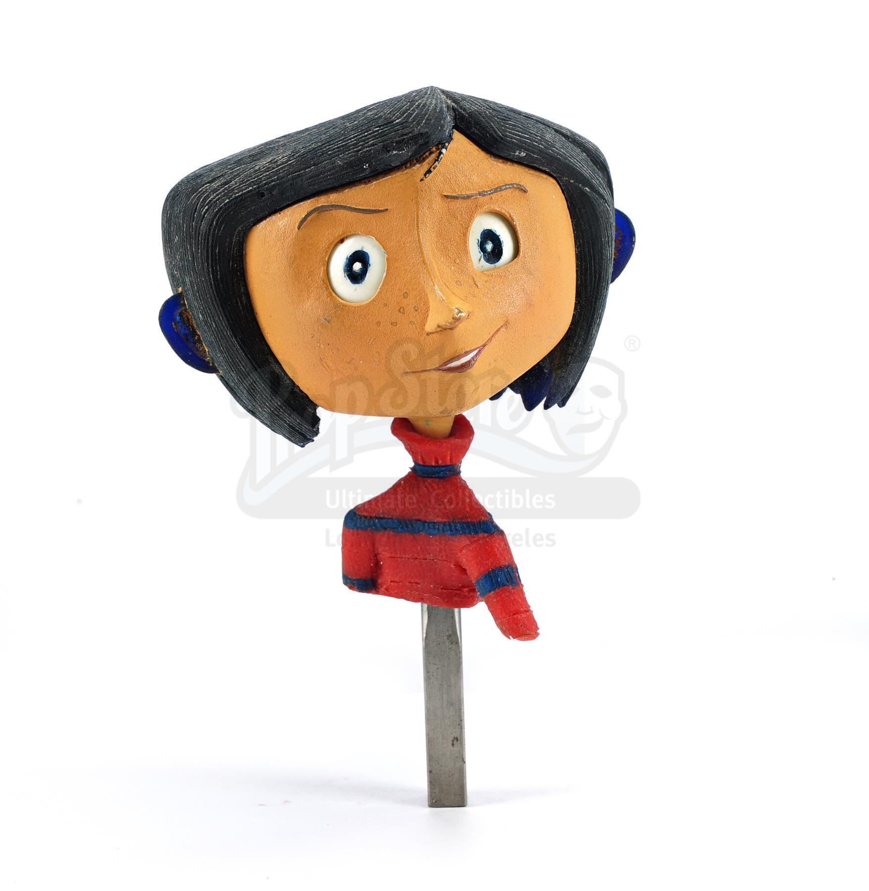 Lot # 54: CORALINE - First-Ever Prototype Coraline Jones (Dakota Fanning) Puppet Built for the Film