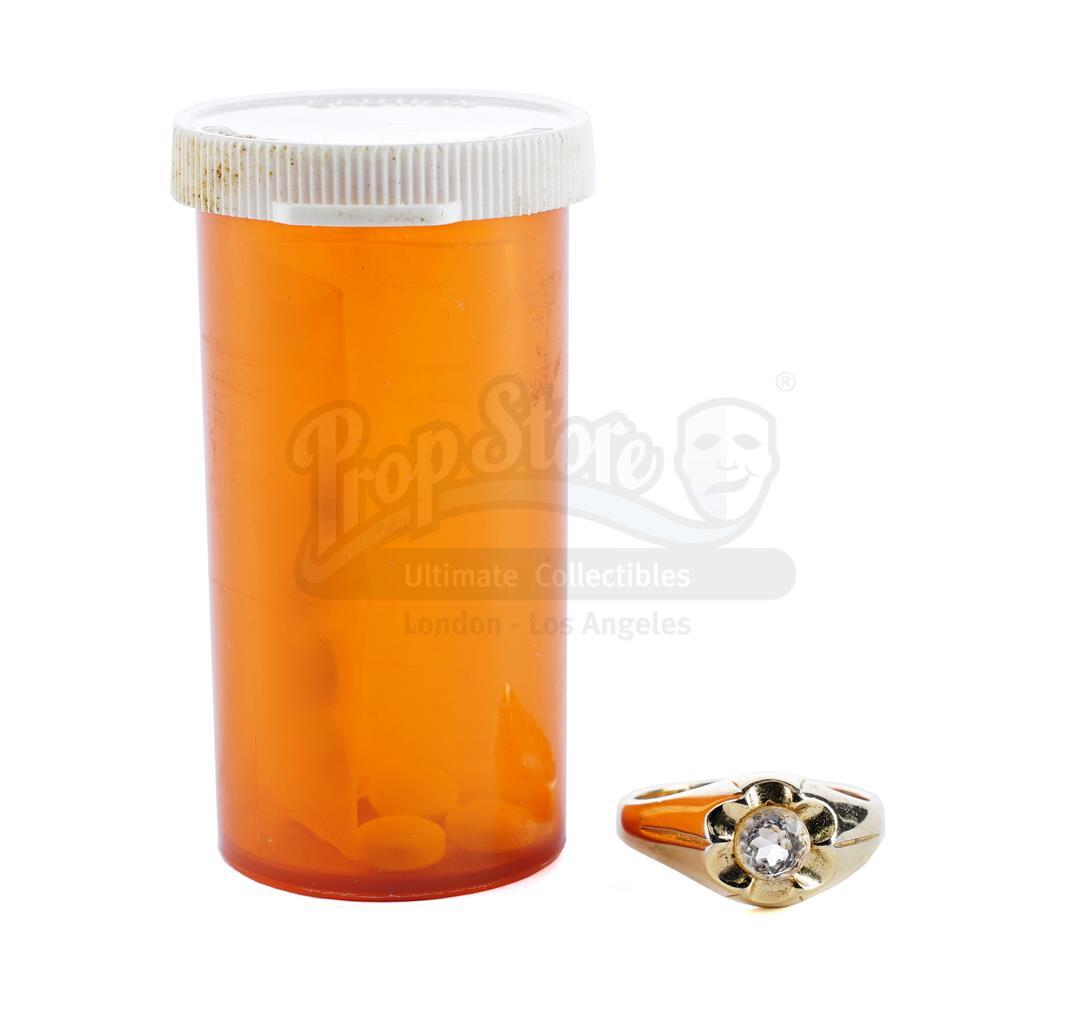 Lot # 92: GOODFELLAS - Henry Hill's (Ray Liotta) Pinky Ring and Pills