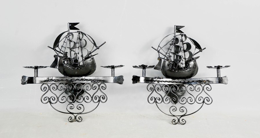 A pair of painted iron wall lights, in the form of ships. 30cms x 28cms