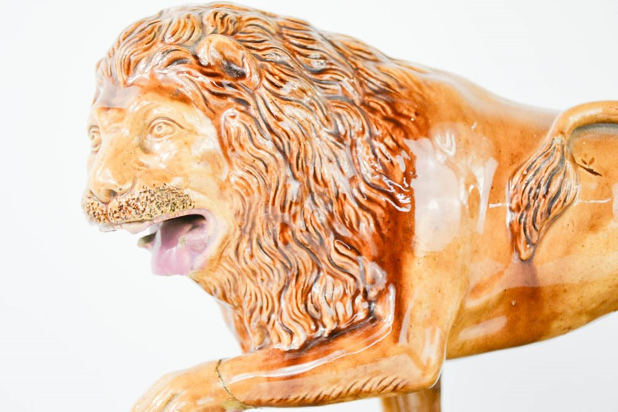 A Victorian Majolica performing lion figure. Standing on rectangular plinth base with mottled glazes - Image 2 of 2