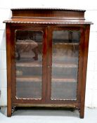 An Edwardian glazed mahogany cabinet, with two glazed doors enclosing glass shelves, 120cm high,