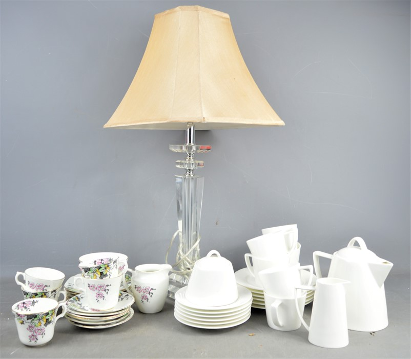 A John Lewis glass table lamp together with a quantity of cups and saucers