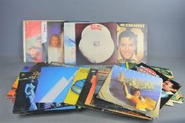 A group of LP records to include: Elvis Presley, Roxy music, Bee Gees, Supertramp, 10cc, Abba, The