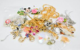 A group of costume jewellery to include crystal pendant, necklaces and brooches.