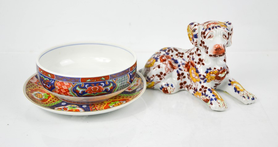 An Imari plate and matching dish together with a Chinese hound, bearing marks to base.