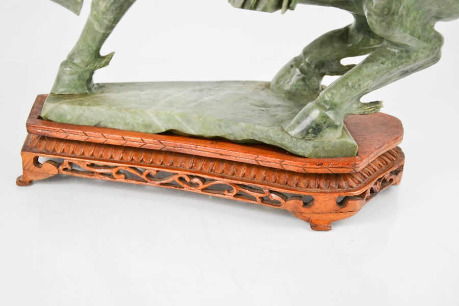 An early 20th century Chinese soapstone horse on wooden stand, 37cm high. - Image 3 of 3