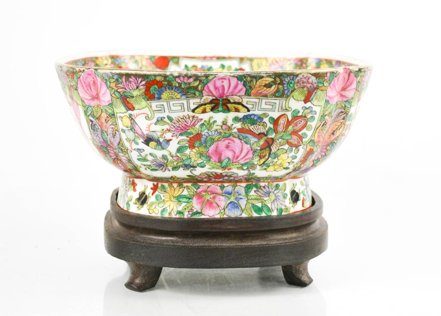 An early 20th century Chinese enamelled bowl on stand, depicting panels of flowers, birds and