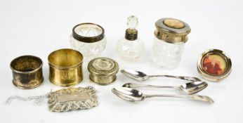 Three silver spoons, a silver napkin ring, a small circular silver photograph frame, a silver and