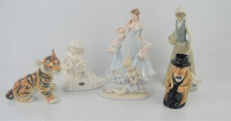 A Royal Winston Churchill jug , Nao figurine , Russian pottery tiger cub and a Royal Worcester