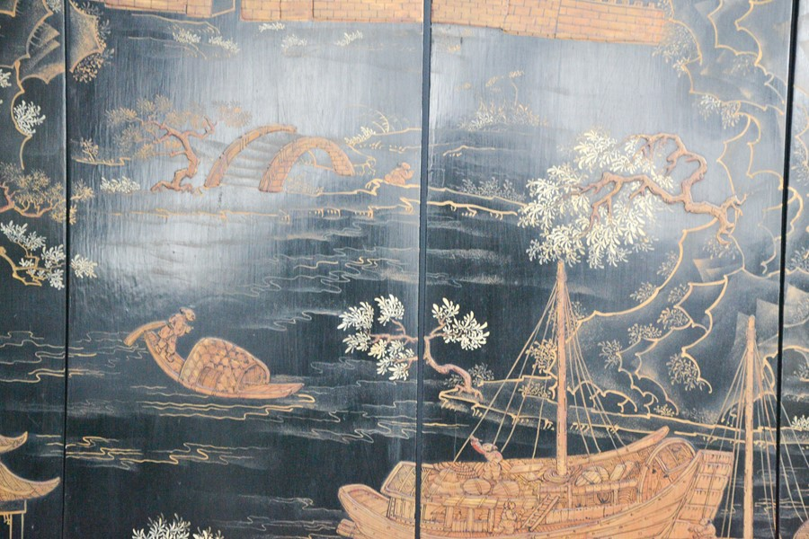 A set of four late 19th century black lacquered Chinese panels, depicting junks and town scenes - Image 2 of 2
